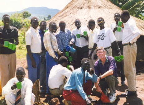 Jim Sutherland and Sudanese refugee students at Kiryandongo